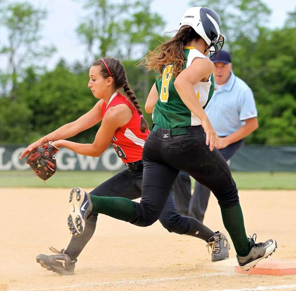 Longwood's Nicole Gazzola tries to beat the throw