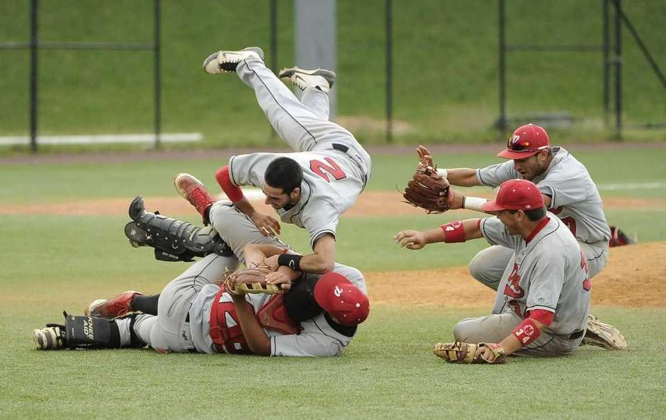 Plainedge shortstop Ralph Caccavale (2) dives on to