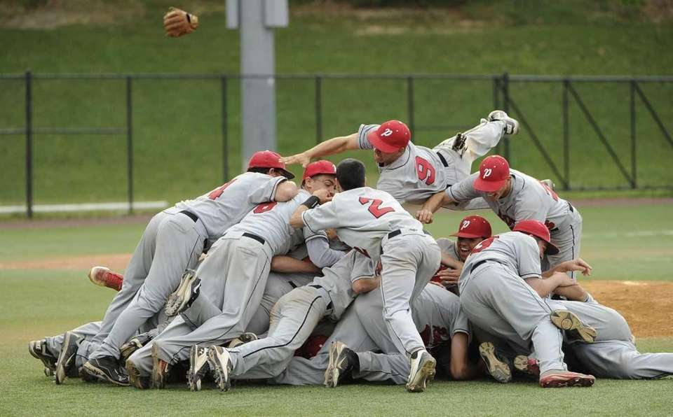 Plainedge players celebrate their 9-2 championship win over