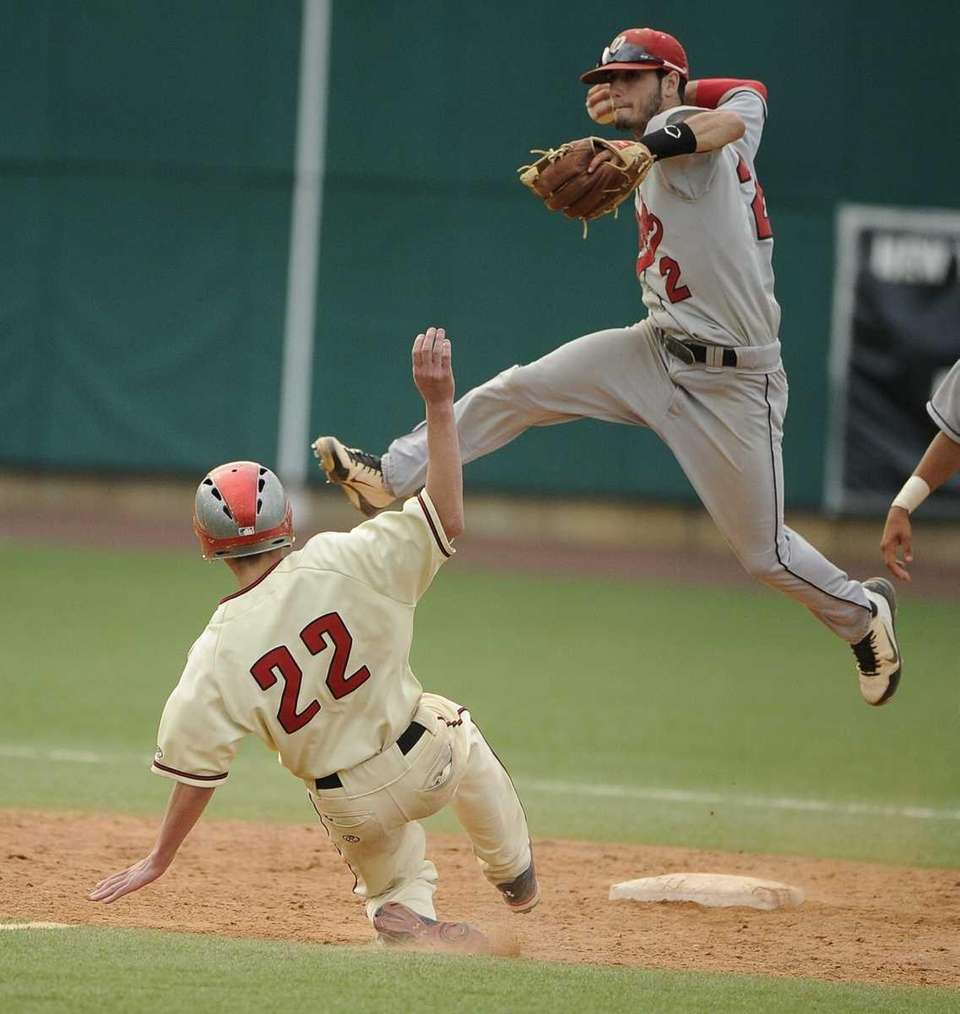 Plainedge shortstop Ralph Caccavale turns a double play
