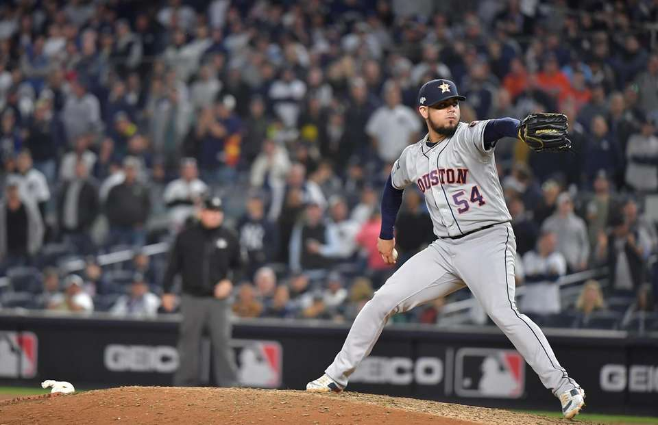 Houston Astros relief pitcher Roberto Osuna (54) delivers