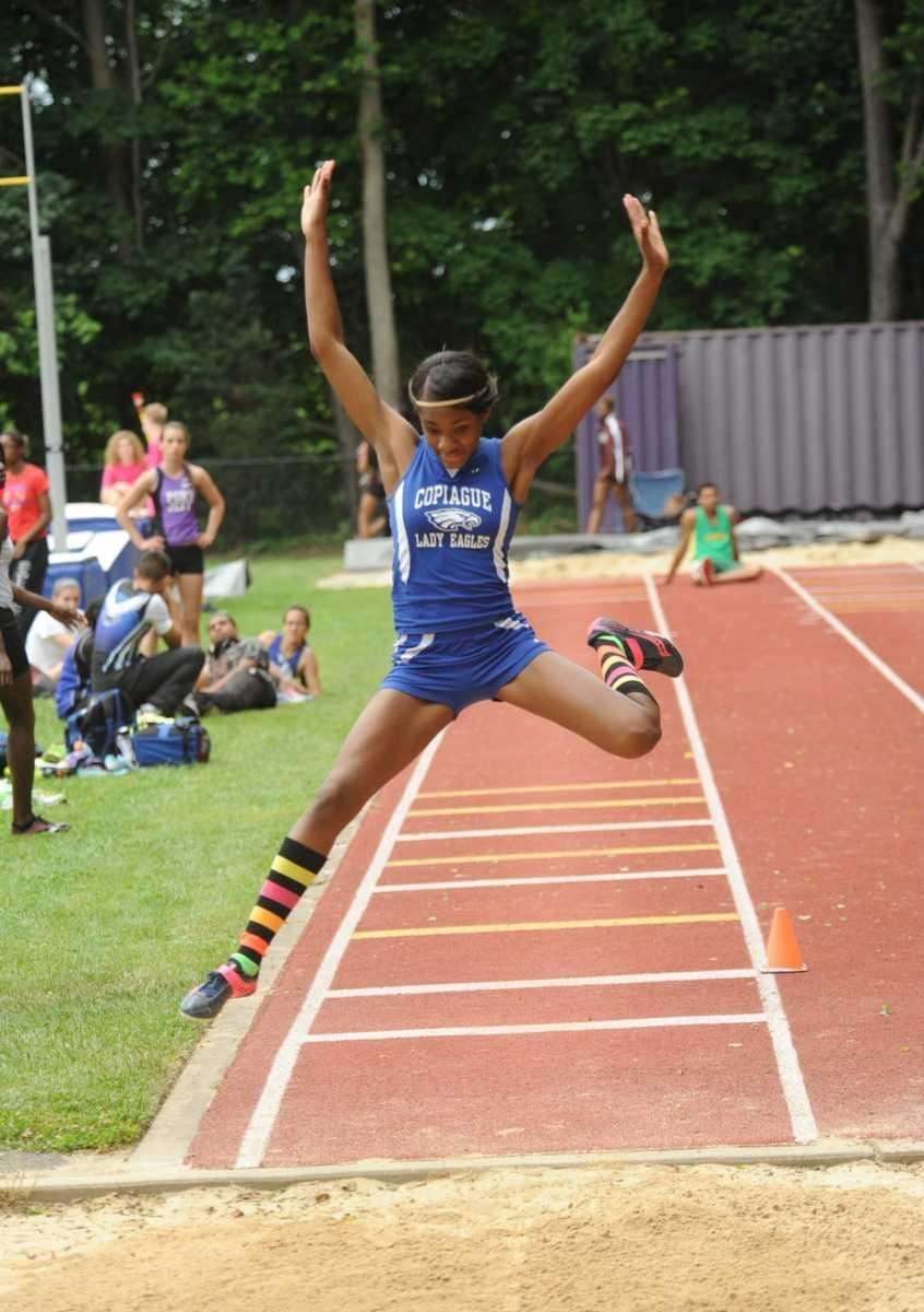 Janel Francis of Copiague leaps during the girls