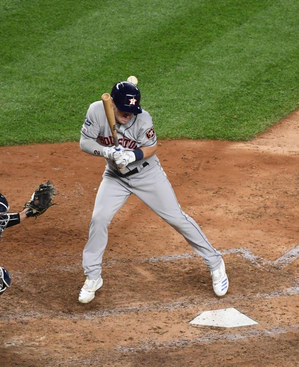Houston Astros third baseman Alex Bregman (2) gets