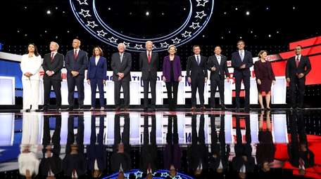 The 12 candidates onstage for the Democratic presidential