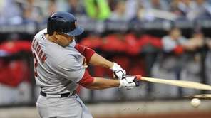 Carlos Beltran breaks his bat during his first