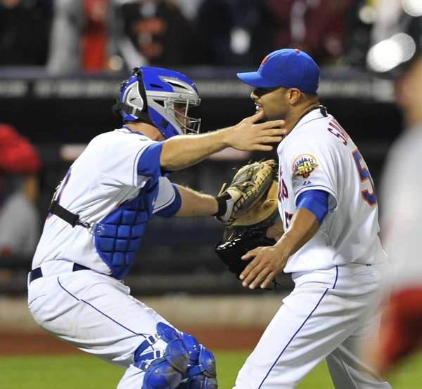 Josh Thole embraces Johan Santana after his no-hitter.