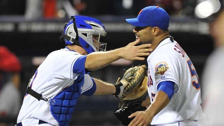 Josh Thole embraces Johan Santana after his no-hitter.