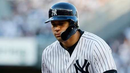 Gary Sanchez #24 of the Yankees walks back