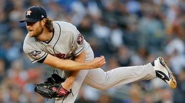 Gerrit Cole #45 of the Houston Astros pitches