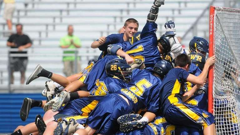 Shoreham-Wading River teammates celebrate after their 9-7 win