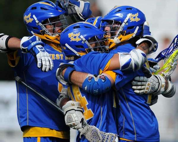 West Islip's #42 Brendan Smith, right, gets congratulated