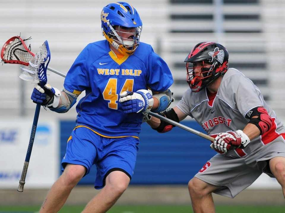 West Islip's #44 Tom Moore, left, gets pressured