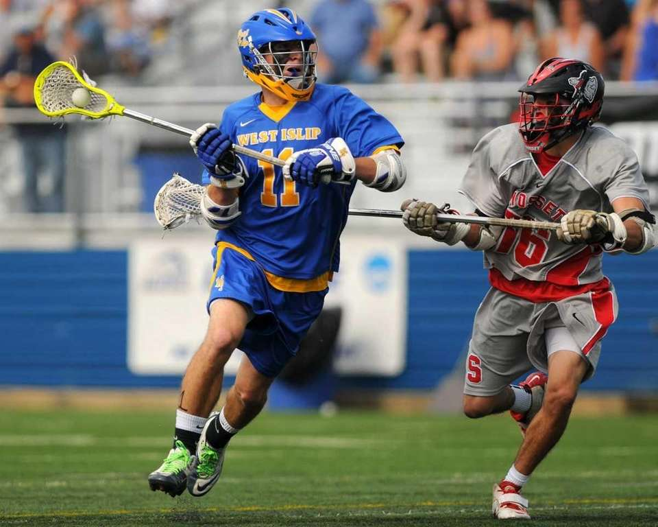 West Islip's Nick Aponte, left, looks to pass