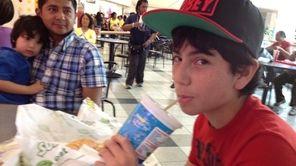 David Araujo,14, shares a 40-ounce soda with his