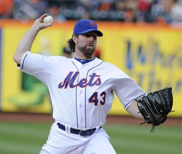 NY Mets pitcher R.A. Dickey delivers in the