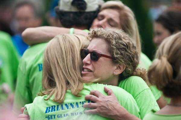 Randi Schuller hugs Dawn Titcomb during the walk.