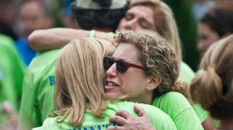 Randi Schuller hugs Dawn Titcomb during the walk.