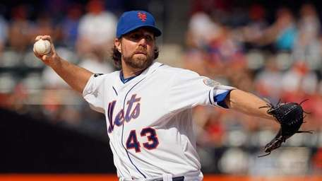 R.A. Dickey #43 of the Mets delivers a
