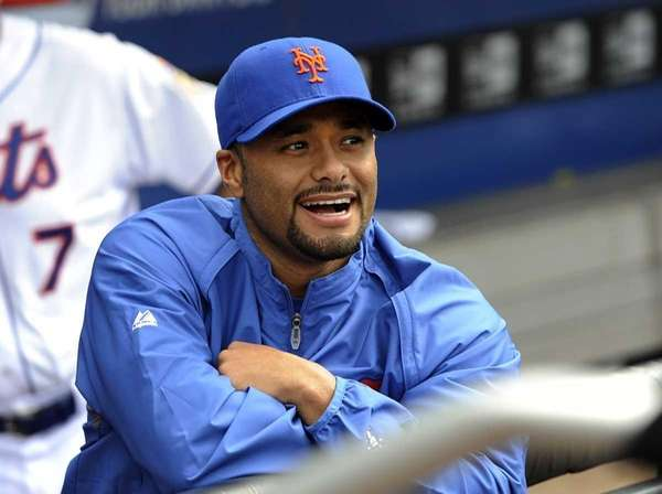 Johan Santana smiles in the dugout as he