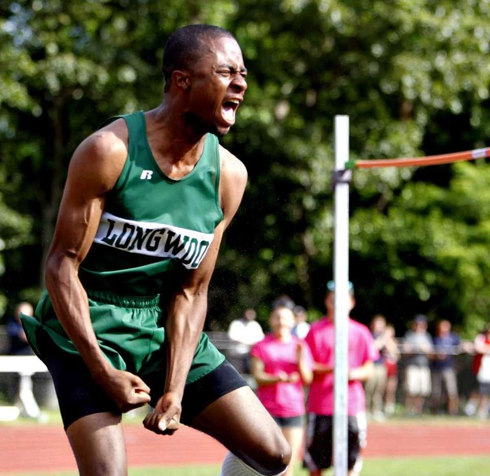 Longwood's Mark Jackson celebrates after clearing 6'10