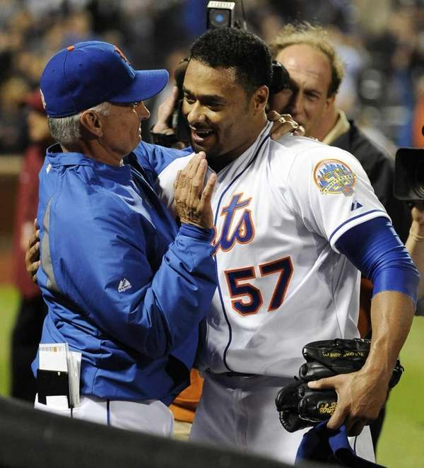 Mets starting pitcher Johan Santana hugs manager Terry