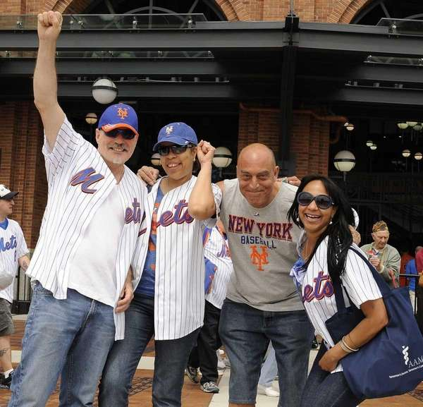 Mets fans cheer outside Citi Field before the