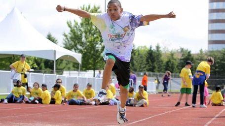 Christian Muniz, 11, of Tuckahoe, participates in the
