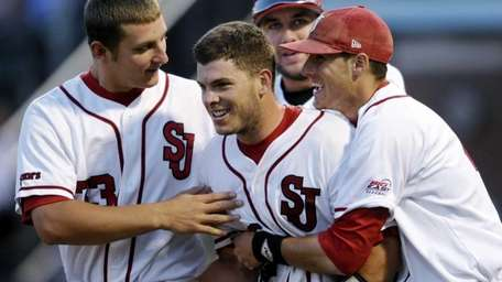 St. John's Danny Bethea is congratulated by teammates