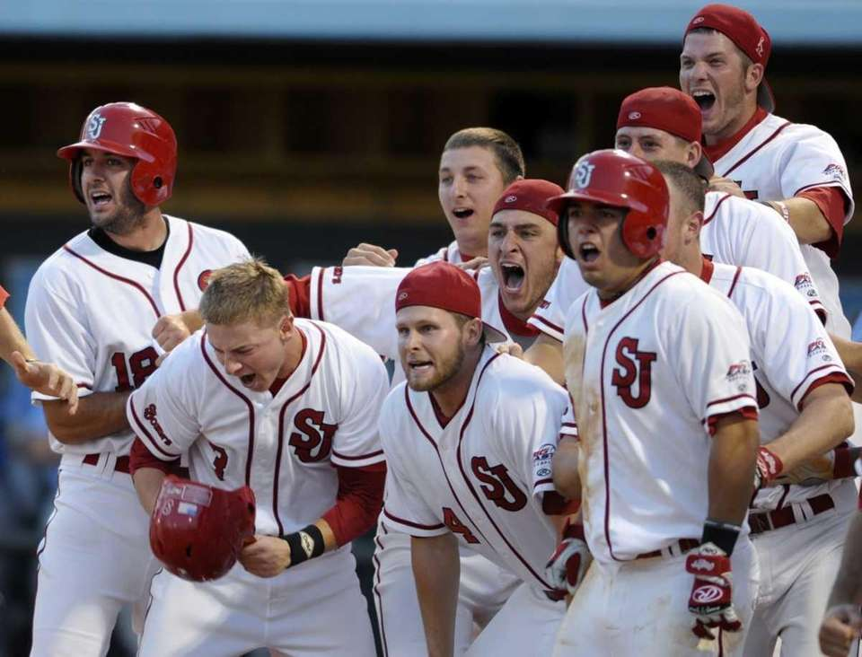 St. John's players wait at the plate for