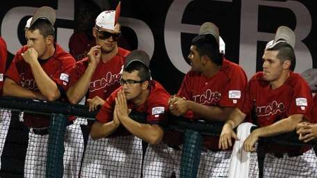 Stony Brook players watch from the dugout as