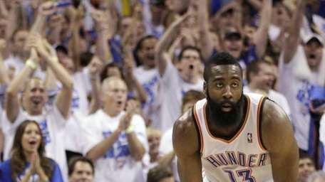 Oklahoma City Thunder guard James Harden gestures during