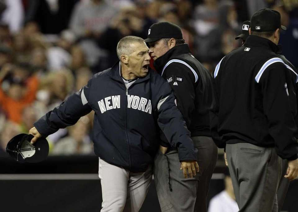 Yankees manager Joe Girardi, left, goes around umpire