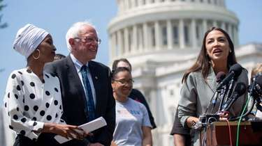 Rep. Alexandria Ocasio-Cortez, right, speaks alongside Sen. Bernie
