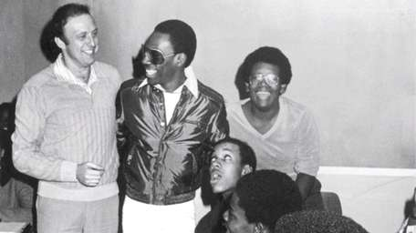Comedian and movie star Eddie Murphy (in sunglasses)