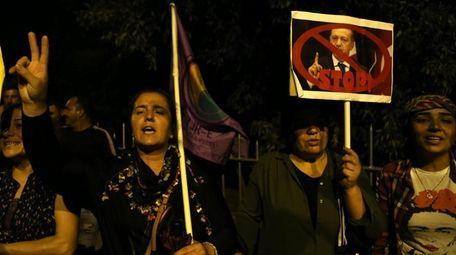Kurdish women living in Cyprus shout slogans and