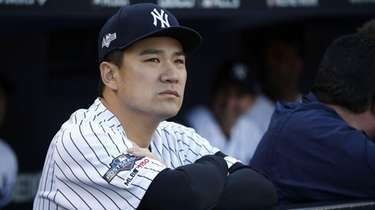 Yankees pitcher Masahiro Tanaka in the dugout in