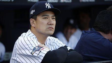 Yankees pitcher Masahiro Tanaka in the dugout in
