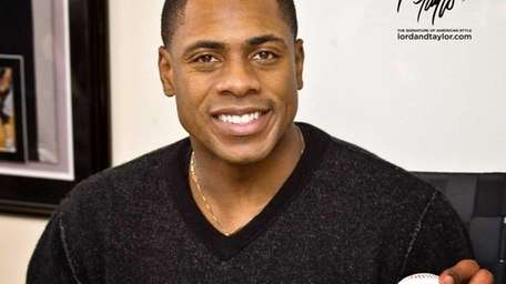 New York Yankees' outfielder Curtis Granderson stops by