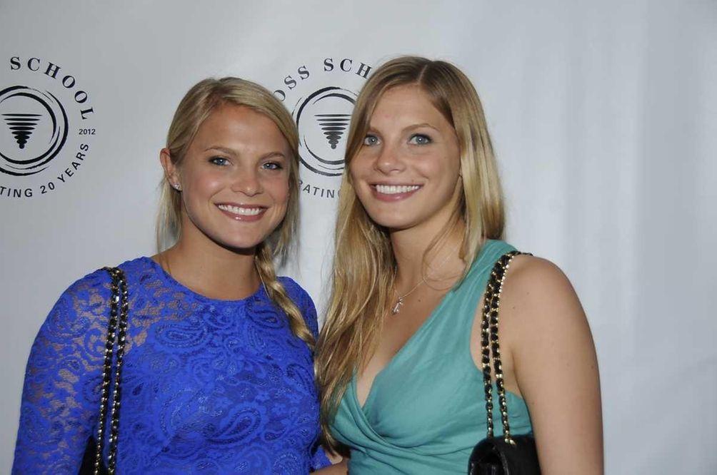 Katie Meringoff, left, and her sister, Charlotte, arrive