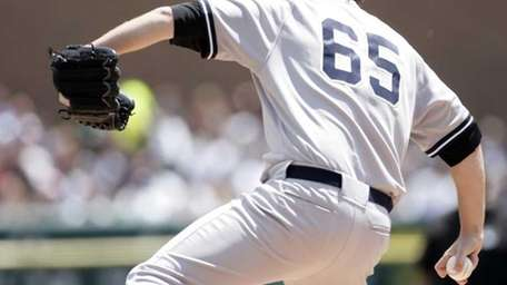 Yankees starter Phil Hughes pitches against the Detroit