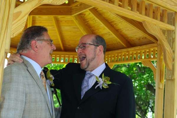 Dr. Alan Stahl, left, marries his longtime partner,
