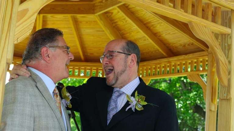 Dr. Alan Stahl, left, marries his longtime partner,