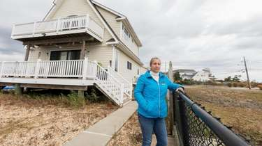 Roseann Frisch is considering purchasing an empty lot