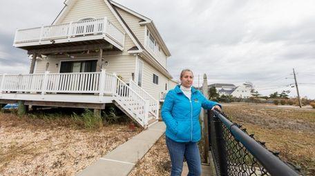 Roseann Frisch is considering purchasing an empty lot