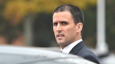 Joseph Guida, 44, leaves court in Central Islip