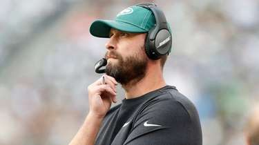 Jets head coach Adam Gase looks on in