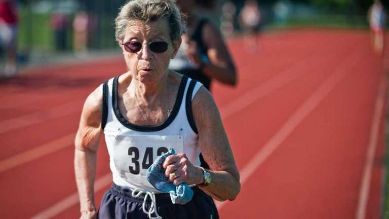 Helen Belden runs during the 5K running event.