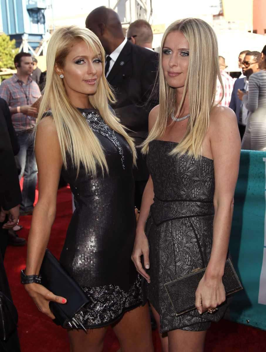 Paris Hilton, left, and Nicky Hilton arrive at