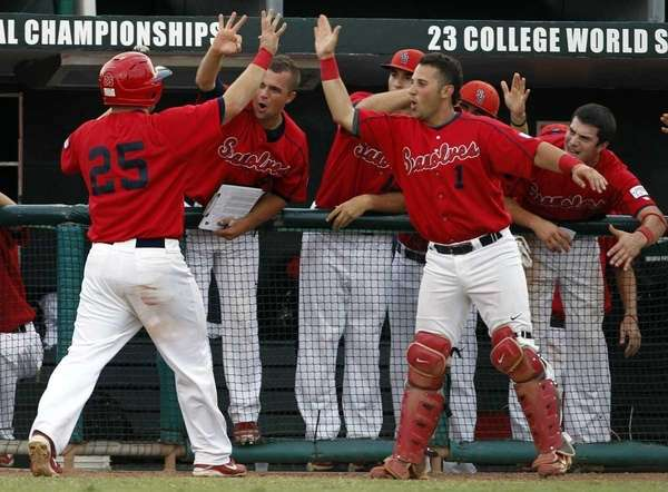 Stony Brook's Kevin Courtney (25) is met in