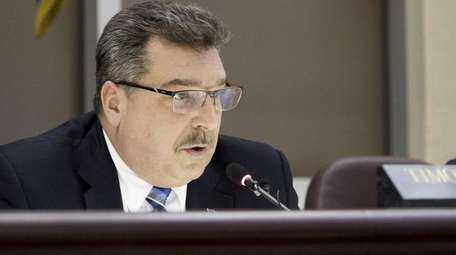 Glen Cove Mayor Timothy Tenke presides over a
